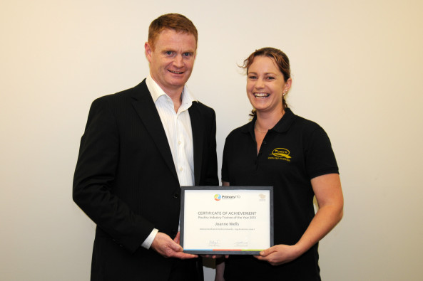Joanne Wells, 2013 Poultry Trainee of the Year, receives her award from PIANZ Chairman, Adrian Revell.